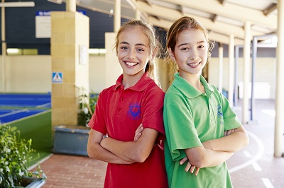 Two young girls on school grounds