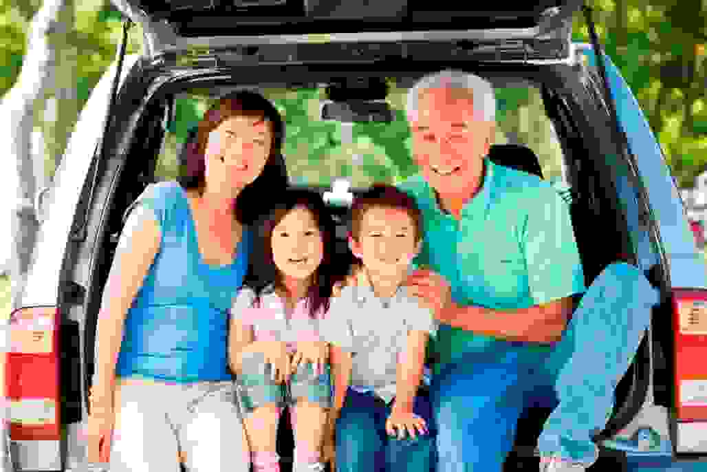 Grandparents with kids in the back of station wagon.jpg