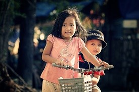 Two young kids on bikes
