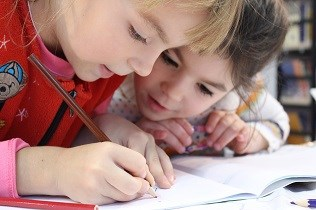 Young children drawing together
