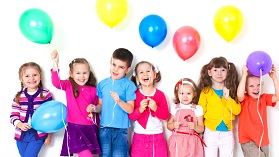 Kids celebrating with balloons